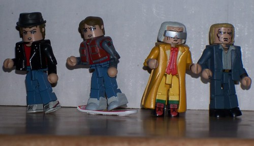 Marty in disguise, Marty on the hoverboard, Future Doc Brown, and Alternate 1985 Biff