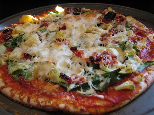 Baked pizza -- see the charred bits of sun-dried tomatoes?  Amazing!