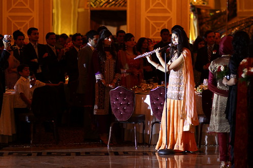 playing the flute at the shadi