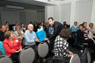 Gary Schlee receives a gift from Smojoe in audience at IABC conference