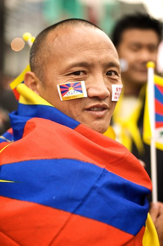 An exiled Tibetan monk joins in the protest in Taipei, Taiwan.