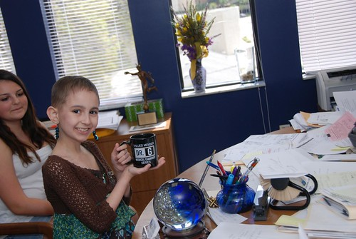 Talia proudly shows her Dr. G mug