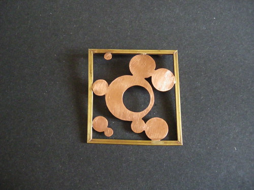 Copper and brass pin I made last semester. I guess I was inspired by bubbles and crop circles.