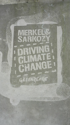 Greenpeace graffitti on a wall by the European Parliament