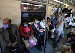 people wearing surgical masks on Mexico subway