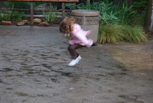 Allie jumping in puddles