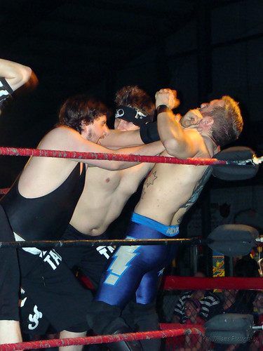 Pierre Abernathy and Evan Gelistico double-team Dingo during the battle of the Submission Squads. Photo by Kari Williams