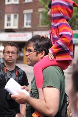 Roncesvalles Renewed Street Walk: member volunteer on the walk with child on board.