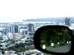 Port Louis behind the car mirror
