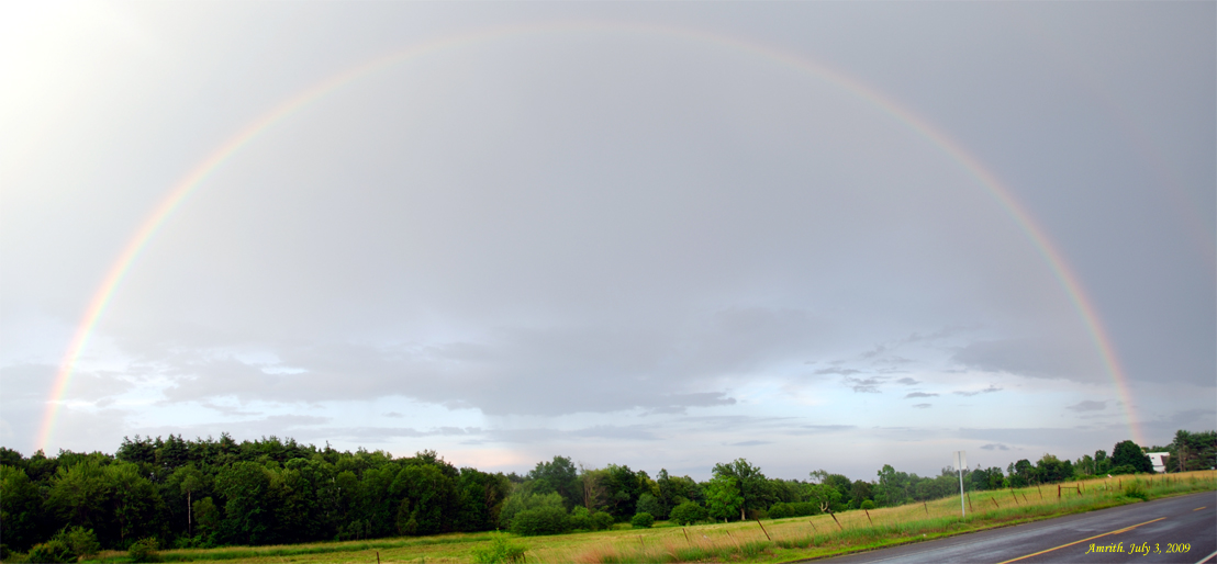 Panoramic image of a rainbow