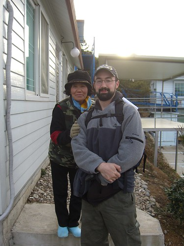 Mrs. Kim and David pose outside of the White Pension, the morning of our actual departure.