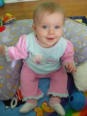Sitting up and smiling for the camera