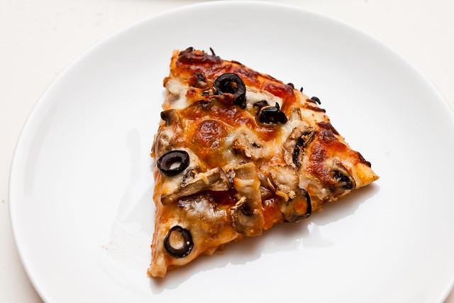 sausage mushroom and black olive pizza slice