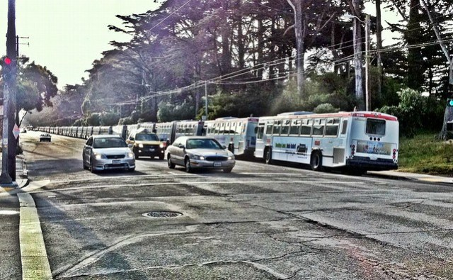 Muni buses lined up along Fulton st.