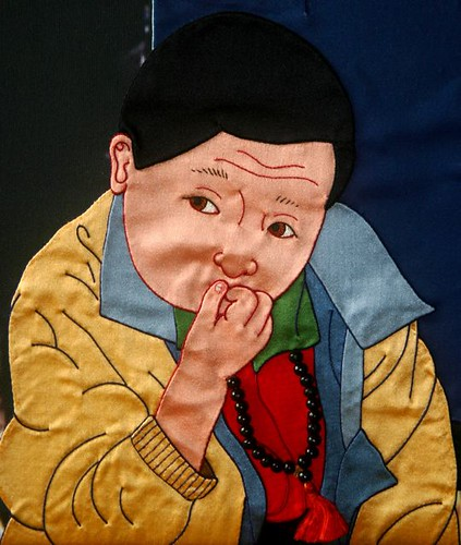 Pool of Light, detail. Tibetan silk appliqué by Leslie Rinchen-Wongmo
