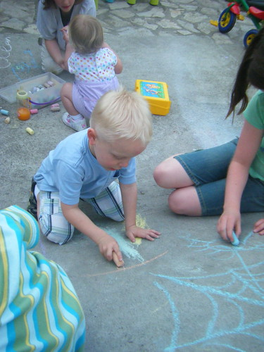 The kids played with sidwalk chalk