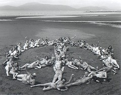 naked people form peace sign on Wreck Beach