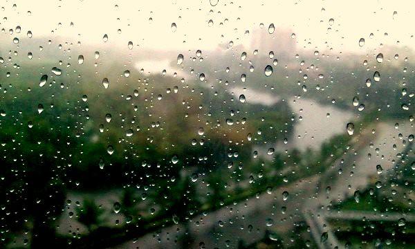 Monsoon first rain drops lingers on the office window