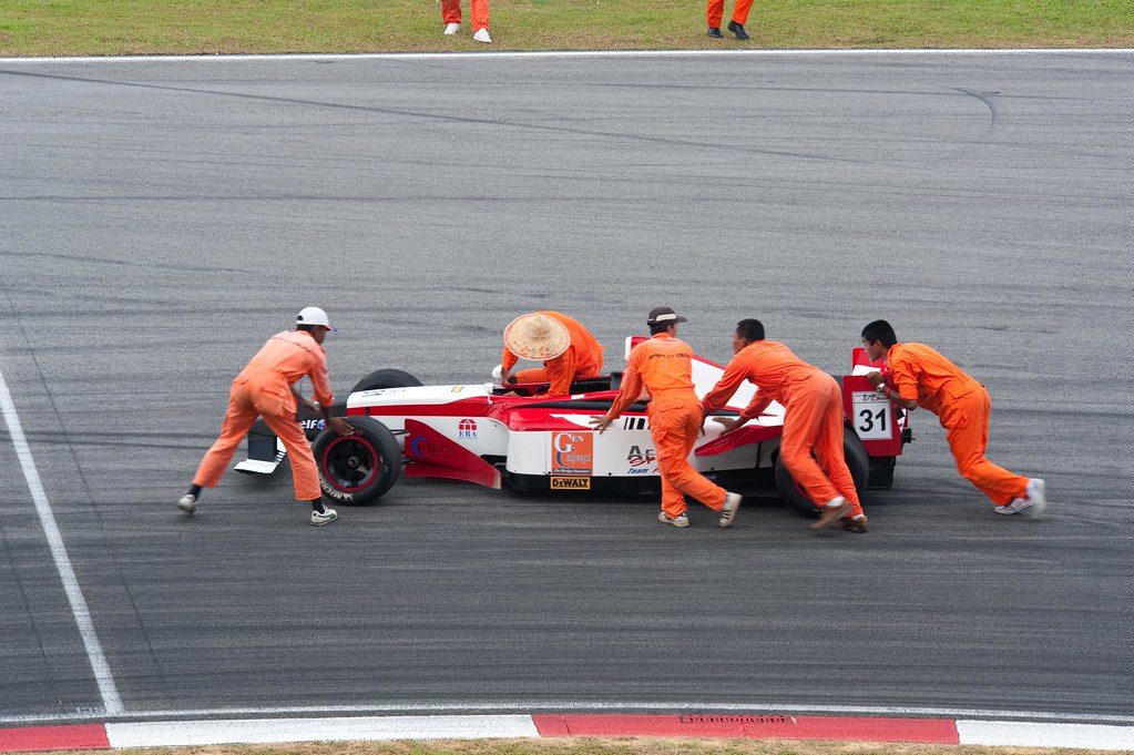 Marshals pushing car out of the way