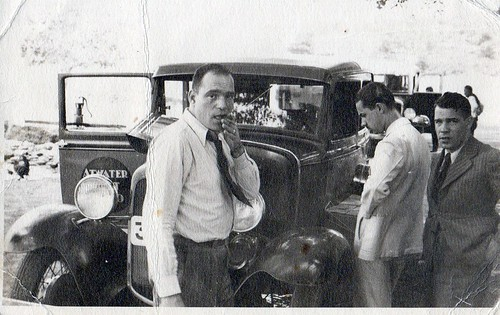 My dad had just returned from his immigrant years in the USA. He brought the first radios in Greece, the well known (at the time) brand of Atwaterkent. Here his car has broken down and all look stressed and gloomy :-(