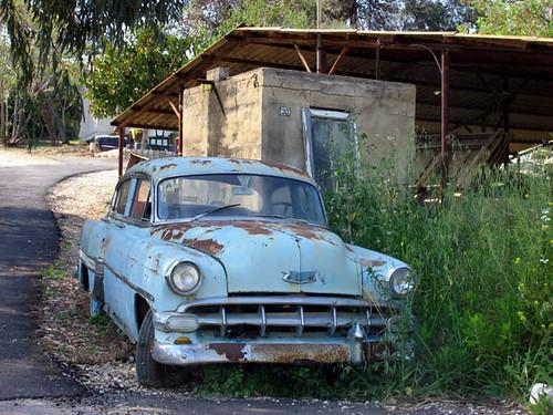 deserted light blue car