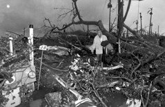 Harold Wilkins walks through rubble left by Hu...