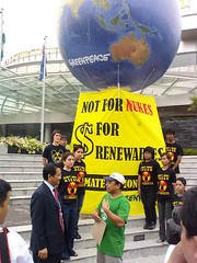 Tara delivers our message to the Thail delegate: Nuclear power is bad for Southeast Asias future!