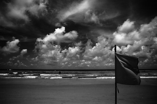 Bintan Lagoon Beach. Shot when the tide was high. The flag indicates the section of the beach that was clsoed.