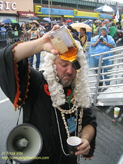 Chief Justice pours first bribe of  Mermaid Parade. Photo © Tricia Vita/me-myself-i via flickr