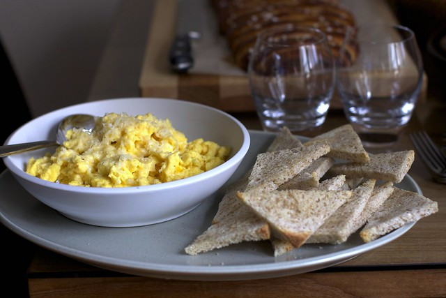 hasty, cheesy scrambled eggs; buttered toast