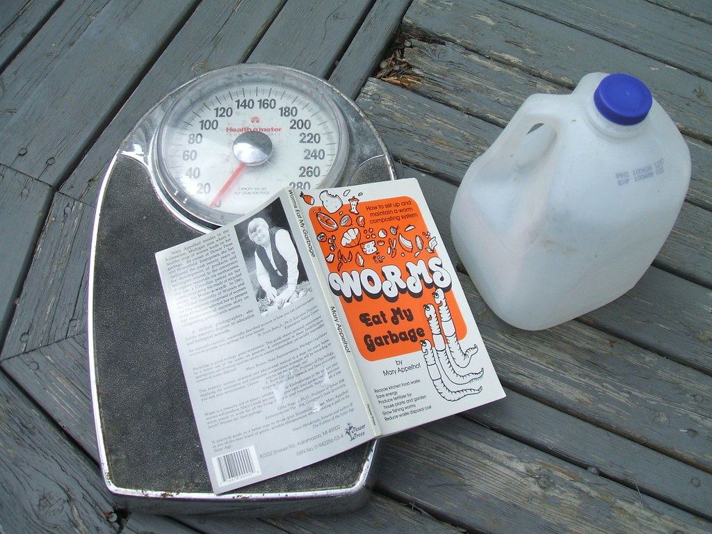 Worm bin book, scale for weighing water, jug