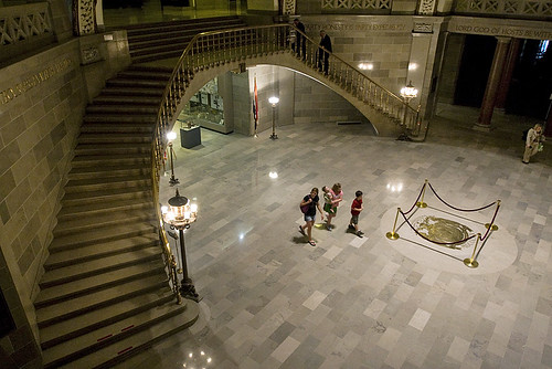 A family walks around the statehouse rotunda after the legislative session adjourned.