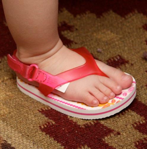 baby foot in a flip flop