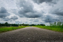 Dutch sky above country road..