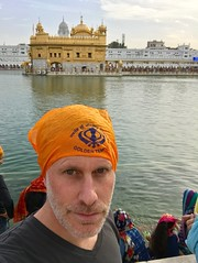 In front of the Golden Temple, barefoot and with mandatory head covering