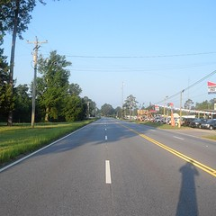 The Road Ahead. Day 90. Rt. 31 in Evergreen, AL. See that shadow? Getting an early start today. Walking past used cart lots and body shops then I'll be in the country all day. Less than a week to the Gulf of Mexico. #TheWorldWalk #travel #wwtheroadahead
