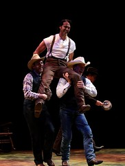 """Jeremiah James (center) as Curly with Jeff Kuhr and Ryan Worsing in the 2010 Music Circus production of """"Oklahoma!"""" at the Wells Fargo Pavilion July 27-August 1.  Photo by Charr Crail."""