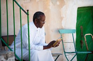 Priest reading