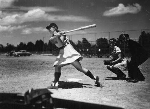 View of All American Girls Professional Baseball League member Dottie Schroeder getting a hit: Opa-locka, Florida
