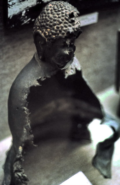 Little Buddha statue melted by atomic bomb at memorial museum in Hiroshima, Japan 1985