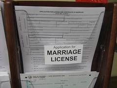 Photo of marriage license applications in a plastic box