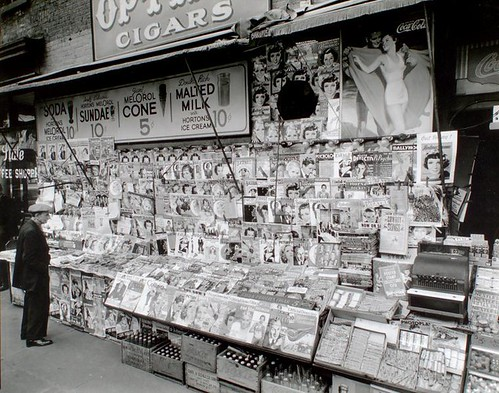Man standing at a New York newsstand