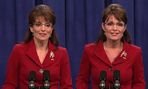 A photo of Tina Fey impersonating Sarah Palin and standing next to Sarah Palin. From an SNL sketch