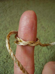 Finger with string: Some rights reserved by mwoodard/Flickr