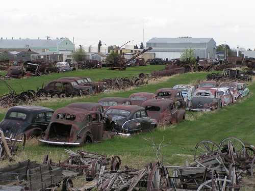 Old rusty cars and agricultural equipment