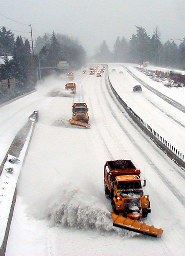 plowing in tandem on U.S. 26 in Portland
