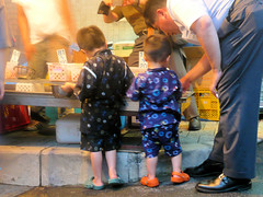 Little boys catching goldfishes - Gion Matsuri