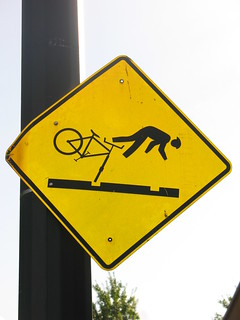 sign: bicyclists watch out for rail tracks