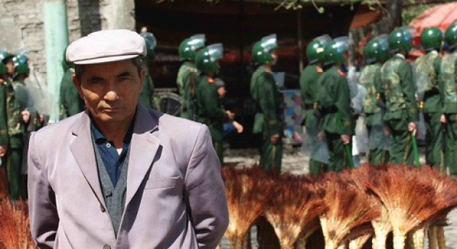 Uygurs Peddler and Armed police,Hanren street,Yining City,Xinjiang,2009