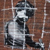 Banksy in Boston: Detail of the NO LOITRIN piece on Essex St in Central Square, Cambridge.